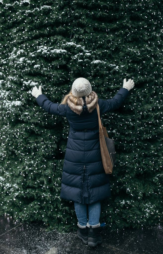Happy woman enjoying Christmas