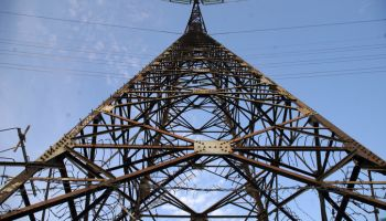 Low Angle View Electricity Pylon Against Blue Sky