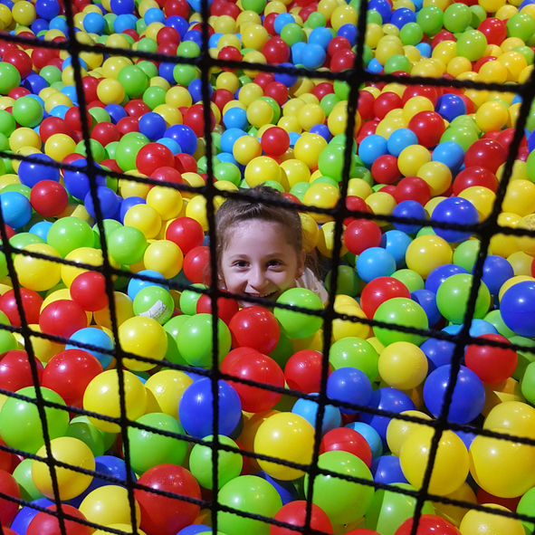 Portrait Of Smiling Girl Playing In Ball Pool