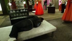 4/20/04- Bloomington, MN - As high school girls try on prom dresses at Glitz at the Mall of America, a friend of one of them patiently waits in the front of the store.