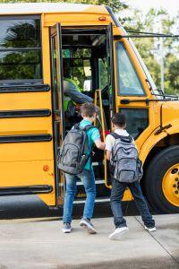 Boys boarding school bus