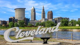 Cleveland script sign and city skyline - Flats West Bank