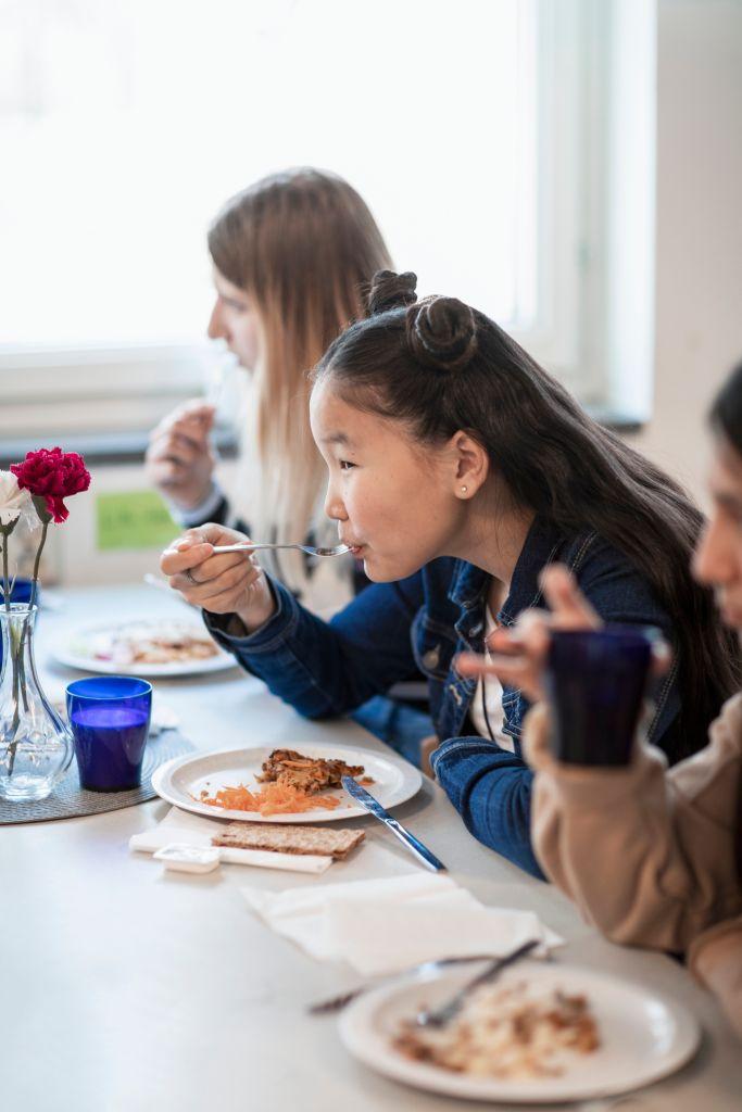 Girl eating lunch school canteen