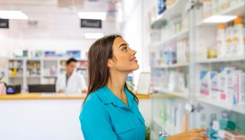 Beautiful woman shopping at pharmacy