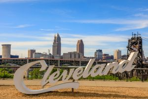 Cleveland script sign and city skyline - Tremont