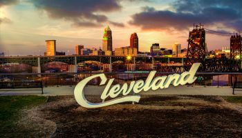 Cleveland script sign and city skyline in the evening - Tremont