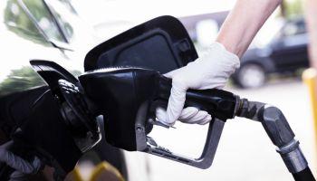 Woman pumps gas during coronavirus pandemic