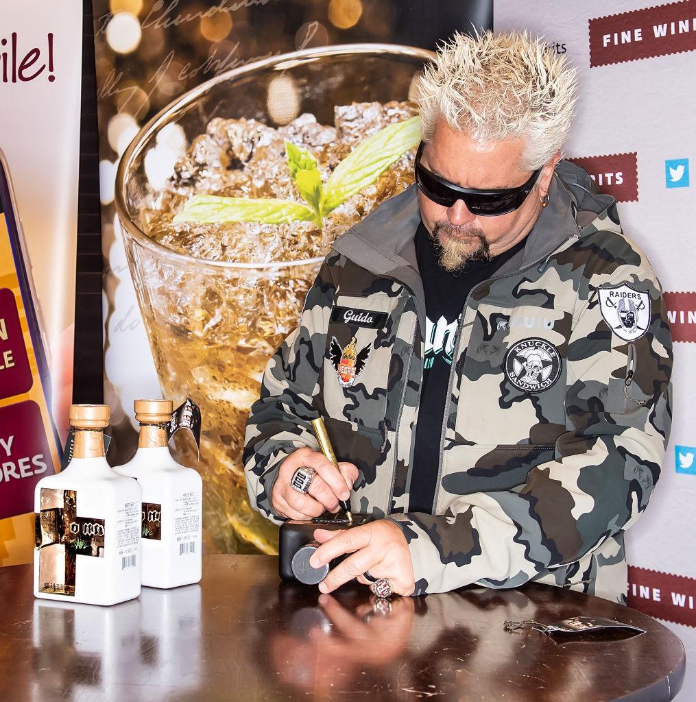 Guy Fieri Signs Bottles Of Santo Fino Tequila Blanco