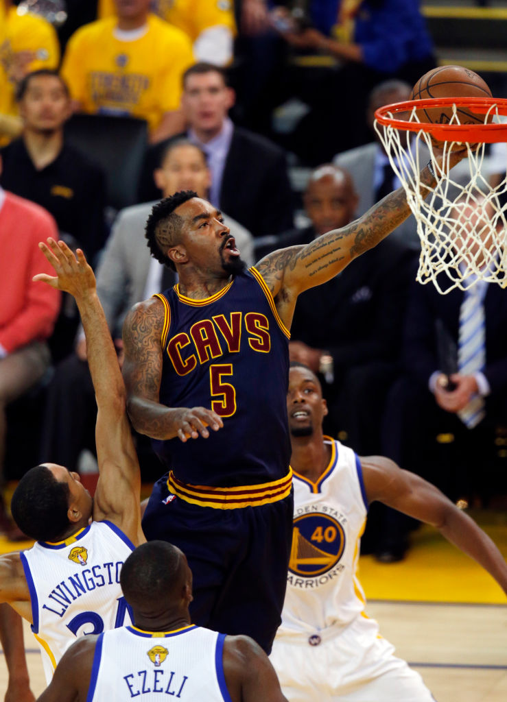 Cleveland Cavaliers' J.R. Smith (5) drives to the hoop between Golden State Warriors defenders in the first quarter of Game 2 of the NBA Finals at Oracle Arena in Oakland, Calif., on Sunday, June 7, 2015. (Nhat V. Meyer/Bay Area News Group)