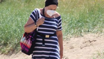 People wear protective masks in the 90 degree heat\nPeople head to the beach at the popular seaside resort of Skegness as England has it's hottest day of the year with temperatures well into the 30 degrees celcius. Skegness, UK on June 25th 2020