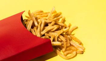 French Fries On Yellow Background