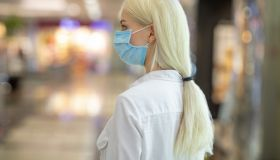 Woman wear face mask walk around shopping district
