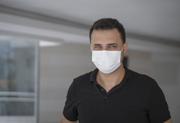 Portrait of a mature man with protective face mask in the office