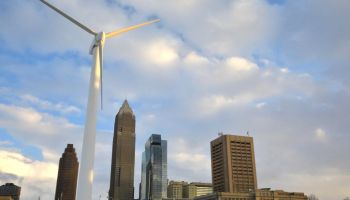 Downtown city buildings powered from a wind energy turbine