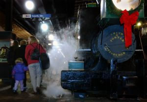 Duluth,Mn.,Fri.,Nov. 26, 2004--Passengers aboard the Polar Express which travelled from Fitger's Inn to the Lake Superior Railraod Museum, walk past a steamy Minnetonka (the first engine on the Northern Pacific Line), on their way to a reading of Chris Va
