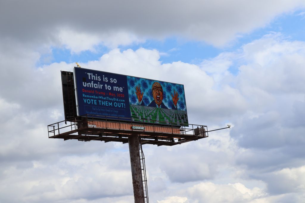 Barrage Of Anti-Trump Billboards Greet President In Cleveland On Way To Presidential Debate